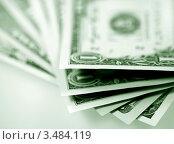 Купить «Пачка купюр - американские доллары», фото № 3484119, снято 4 марта 2011 г. (c) ElenArt / Фотобанк Лори