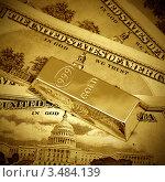 Купить «Деньги и золотой слиток, тонировано», фото № 3484139, снято 4 марта 2011 г. (c) ElenArt / Фотобанк Лори