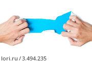 Купить «Женские руки рвут белый лист бумаги», фото № 3494235, снято 18 сентября 2011 г. (c) Константин Ёлшин / Фотобанк Лори
