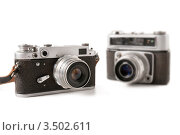 Два старых фотоаппарата на белом фоне. Стоковое фото, фотограф Хромушин Тарас / Фотобанк Лори
