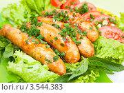 Купить «Жареные сосиски с овощами и зеленью», фото № 3544383, снято 25 мая 2012 г. (c) Истомина Елена / Фотобанк Лори