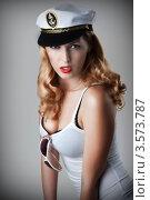 Купить «Привлекательная блондинка в капитанской фуражке», фото № 3573787, снято 2 июня 2012 г. (c) katalinks / Фотобанк Лори