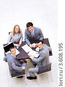 Купить «Коллеги работают за столом, вид сверху», фото № 3608195, снято 6 апреля 2012 г. (c) Raev Denis / Фотобанк Лори