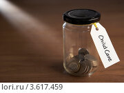 "Купить «Монетки в банке с ярлыком ""На детей""», фото № 3617459, снято 24 августа 2011 г. (c) Monkey Business Images / Фотобанк Лори"