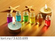 Купить «Бутылки с ароматными маслами и свечи», фото № 3633699, снято 14 апреля 2011 г. (c) Losevsky Pavel / Фотобанк Лори