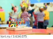 Купить «Красочная игрушка на деревянной подставке на столе в детском саду», фото № 3634075, снято 5 марта 2011 г. (c) Losevsky Pavel / Фотобанк Лори