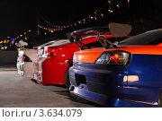 Купить «Автомобили на парковке. Бамперы и спойлеры», фото № 3634079, снято 26 апреля 2011 г. (c) Losevsky Pavel / Фотобанк Лори
