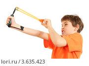 Купить «Мальчик приготовился стрелять из рогатки, белый фон», фото № 3635423, снято 1 апреля 2011 г. (c) Losevsky Pavel / Фотобанк Лори