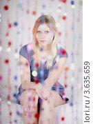 Купить «Портрет молодой девушки, которая сидит за занавесом из пластиковых бусин», фото № 3635659, снято 17 февраля 2011 г. (c) Losevsky Pavel / Фотобанк Лори