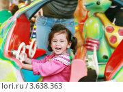 Купить «Радостная девочка на аттракционе», фото № 3638363, снято 5 мая 2012 г. (c) David Castillo Dominici / Фотобанк Лори