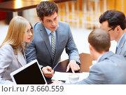 Купить «Совещание в офисе, бизнесмены за столом», фото № 3660559, снято 6 апреля 2012 г. (c) Raev Denis / Фотобанк Лори