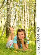 Купить «Девушка лежит на опушке леса», эксклюзивное фото № 3661763, снято 8 июля 2012 г. (c) Юрий Морозов / Фотобанк Лори