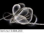 Купить «Свёрнутая лента с белыми светодиодами на тёмном фоне», фото № 3684203, снято 18 марта 2012 г. (c) Абышев А.А. / Фотобанк Лори