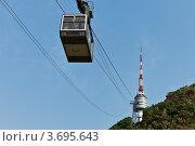 Купить «Сеул. Канатная дорога к телебашне на горе Намсан (Namsan Seoul Tower)», фото № 3695643, снято 8 июля 2012 г. (c) Виктория Катьянова / Фотобанк Лори