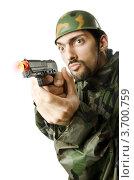 Купить «Игрушечный пистолет с присоской в руках сумасшедшего солдата», фото № 3700759, снято 3 апреля 2012 г. (c) Elnur / Фотобанк Лори
