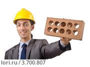 Купить «Строитель держит в руке кирпич», фото № 3700807, снято 22 мая 2012 г. (c) Elnur / Фотобанк Лори