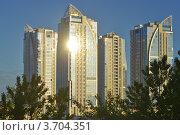 Купить «Высотные жилые дома в лучах утреннего солнца. Санкт-Петербург», эксклюзивное фото № 3704351, снято 5 июня 2012 г. (c) Александр Алексеев / Фотобанк Лори