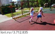 Купить «Две девочки бегают на детской площадке», видеоролик № 3712835, снято 7 декабря 2010 г. (c) Losevsky Pavel / Фотобанк Лори