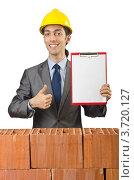 Купить «Строитель за кирпичной стеной показывает пустой баннер», фото № 3720127, снято 22 мая 2012 г. (c) Elnur / Фотобанк Лори