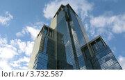 Купить «Московский небоскреб на фоне облачного неба, таймлапс», видеоролик № 3732587, снято 21 декабря 2010 г. (c) Losevsky Pavel / Фотобанк Лори