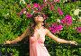 Красивая девушка на фоне цветущей Бугенвилии в Турции, фото № 3734235, снято 16 сентября 2009 г. (c) ElenArt / Фотобанк Лори