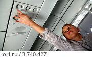 Купить «Мальчик рассматривает фонари освещения на потолке пассажирского салона самолета», видеоролик № 3740427, снято 15 мая 2011 г. (c) Losevsky Pavel / Фотобанк Лори