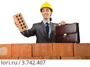 Купить «Строитель за кирпичной стеной держит в руке кирпич», фото № 3742407, снято 22 мая 2012 г. (c) Elnur / Фотобанк Лори