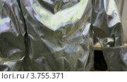 Купить «Защитный костюм для человека из серебристого материала», видеоролик № 3755371, снято 5 ноября 2011 г. (c) Losevsky Pavel / Фотобанк Лори