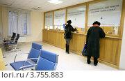 Купить «Женщина отходит от окна, получив документы», видеоролик № 3755883, снято 13 ноября 2011 г. (c) Losevsky Pavel / Фотобанк Лори
