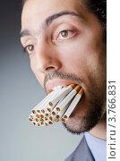 Купить «Мужчина с полным ртом сигарет», фото № 3766831, снято 28 июня 2012 г. (c) Elnur / Фотобанк Лори