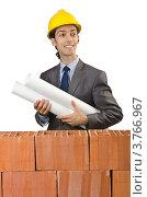 Купить «Строитель с чертежами за кирпичной стеной», фото № 3766967, снято 22 мая 2012 г. (c) Elnur / Фотобанк Лори