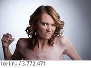 Купить «Агрессивная женщина со сжатым кулаком», фото № 3772471, снято 9 августа 2012 г. (c) Гурьянов Андрей / Фотобанк Лори