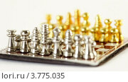 Купить «Игрушечные шахматные фигуры на доске на белом фоне», видеоролик № 3775035, снято 22 февраля 2012 г. (c) Losevsky Pavel / Фотобанк Лори
