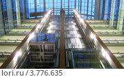 Купить «Лифты опускаются и поднимаются в бизнес центре, таймлапс», видеоролик № 3776635, снято 1 февраля 2012 г. (c) Losevsky Pavel / Фотобанк Лори