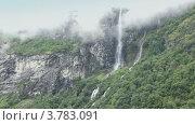 Купить «Водопад из-под облака на горе среди леса в Норвегии», видеоролик № 3783091, снято 16 мая 2012 г. (c) Losevsky Pavel / Фотобанк Лори