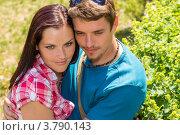 Купить «Влюбленные обнимаются на фоне зеленой листвы», фото № 3790143, снято 26 мая 2012 г. (c) CandyBox Images / Фотобанк Лори