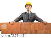 Купить «Строитель за кирпичной стеной», фото № 3791431, снято 22 мая 2012 г. (c) Elnur / Фотобанк Лори