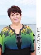Купить «Женщина на фоне моря», эксклюзивное фото № 3799111, снято 30 августа 2012 г. (c) Ольга Линевская / Фотобанк Лори