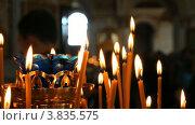 Купить «Горящие свечи в церкви», видеоролик № 3835575, снято 14 сентября 2012 г. (c) Mikhail Erguine / Фотобанк Лори