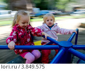 Купить «Две девочки катаются на карусели», фото № 3849575, снято 8 сентября 2012 г. (c) Liseykina / Фотобанк Лори