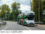 Купить «Автовоз польского автоперевозчика везёт автомобили Opel», фото № 3855891, снято 31 августа 2012 г. (c) Родион Власов / Фотобанк Лори