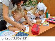 Купить «Учитель помогает ученику писать», эксклюзивное фото № 3869131, снято 24 сентября 2012 г. (c) Вячеслав Палес / Фотобанк Лори