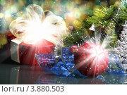 Купить «Новогодняя композиция с елочными игрушками и подарком», фото № 3880503, снято 28 сентября 2012 г. (c) Sergey Nivens / Фотобанк Лори