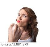 Купить «Смешная молодая женщина показывает кулак», фото № 3881879, снято 9 августа 2012 г. (c) Гурьянов Андрей / Фотобанк Лори