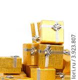 Купить «Золотые коробки с серебряной ленточкой на праздник в подарок», фото № 3923807, снято 18 августа 2012 г. (c) Tatjana Romanova / Фотобанк Лори