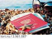 Купить «Натюрморт: путешествие с заграничным паспортом в песке на берегу моря», фото № 3961087, снято 1 октября 2012 г. (c) Константин Лабунский / Фотобанк Лори