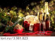 Купить «Новогодний натюрморт с шампанским и подарками», фото № 3981823, снято 28 сентября 2012 г. (c) Sergey Nivens / Фотобанк Лори