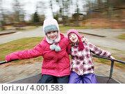Купить «Две девочки катаются на карусели», фото № 4001583, снято 29 декабря 2011 г. (c) Дмитрий Калиновский / Фотобанк Лори