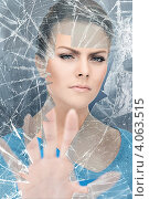 Купить «Женщина у разбитого стекла», фото № 4063515, снято 12 марта 2011 г. (c) Syda Productions / Фотобанк Лори