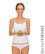 Купить «Юная девушка с косой и стройной фигурой в нижнем белье белого цвета с зеленым яблоком в руке на белом фоне», фото № 4063603, снято 16 сентября 2012 г. (c) Syda Productions / Фотобанк Лори